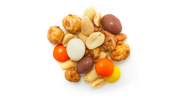 Peanuts, cashews, brazil nuts, hydrogeneted  and non-hydrogenated canola oil, partially dehydrogenated vegetable oils (palm kernel, soybean oils), sugar, salt, glucose, arabic gum, soya lecithin (emulsifier), corn syrup, dextrose,  milk (whole and non-fat), cocoa butter, chocolate liquor, vanilla, yogurt culture, resinous glaze, artificial color (yellow 5 lake, red 40 lake, yellow 6 lake, blue 1 lake), modified cornstarch, carnauba wax, artificial flavors, confectioner's glaze.