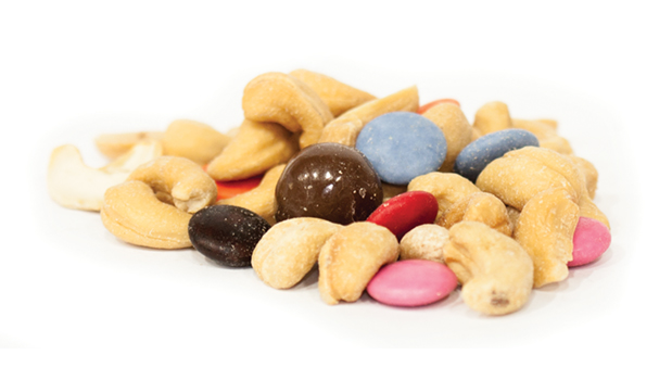 Peanuts, cashews, non-hydrogenated canola oil, milk chocolate (sugar, cocoa butter, milk, chocolate liquor, soy lecithin), corn syrup, partially hydrogenated vegetable oil (one or more of: palm kernel, soybean, cottonseed or coconut oil), arabic gum, modified starch, artificial flavor, salt, confectioner's glaze, xanthan gum, polyglycerol polyricinoleate, wheat flour, modified corn starch, carnaba wax, colour.