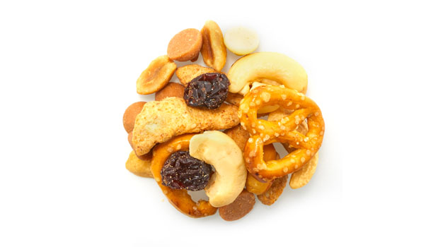 Pretzels [unbleached enriched wheat flour (flour, niacin, reduced iron, thiamine mononitrate-b1, riboflavin-b2, folic acid), salt, malt, soybean oil]; Peanuts; White cocoa butter drops [sugar, cocoa butter, whole milk powder, skim milk powder, soy lecithin (emulsifier), vanilla and natural flavour]; Roasted cashews (cashews, canola oil); Flame raisins (raisins, sunflower oil); Sesame sticks [enriched wheat flour (unbleached wheat flour, malted barley flour, niacin, reduced iron,thiamine mononitrate, riboflavin, folic acid), soybean oil, sesame seeds, bulgur wheat, salt, beet powder (colour), turmeric (colour)]; Peanut butter drops [sugar, hydrogenated palm kernel oil, partially defatted peanut flour, skim milk powder, whey powder, peanut butter (roasted peanuts, hydrogenated rapeseed and cottonseed oil), dextrose, salt, soy lecithin (emulsifier)]; Peanut butter chips [sugar, modified vegetable fat (palm kernel and/or palm), maltodextrin, skim milk powder, colour(s), soy lecithin, artificial flavour(s), salt, natural vanilla extract].