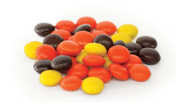 Sugar, partially defatted peanuts, hydrogenated vegetable oil (palm kernel and soybean oil), corn syrup, dextrose, contains 2% or less of: palm kernel oil, artificial color (yellow 5 lake, yellow 6 lake, red 40 lake, blue 1 lake), salt, resinous glaze, soy lecithin, modified cornstarch, vanillin (artificial flavor), carnauba wax, milk.
