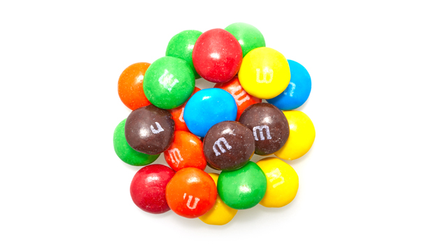 Milk chocolate (sugar, chocolate, skim milk, cocoa butter, lactose, milkfat, soy lecithin, salt, artificial and natural flavors), sugar, cornstarch, less than 1% - corn syrup, dextrin, coloring (includes blue 1 lake, yellow 6, red 40, yellow 5, blue 1, yellow 6 lake, red 40 lake, yellow 5 lake, blue 2 lake, blue 2), carnauba wax, gum acacia.