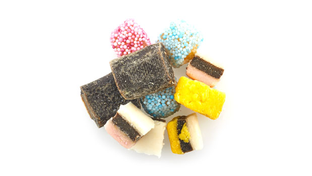 Sugar, molasses, glucose syrup (contains sulphites), enriched wheat flour, desiccated coconut (contains sulphites), corn flour, palm oil, gelatine, natural colours, glycerol, fruit & vegetable juices for colour, cocoa powder, flavours, liquorice extract, beeswax.